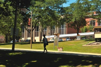 student walking outside Bernhard Center