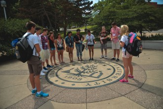 students outside on campus at orientation