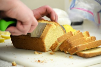 student cutting bread