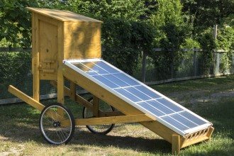 solar panels attached to a wooden rig with a chamber to dry foods