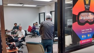 Group of people attending a virtual reality workshop in VR Lab in Waldo Library.