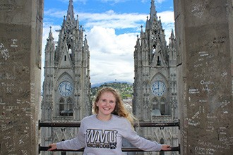 "Jessica Poling at the top of the Catedral de Quito with ""El Pancillo"" in the far background"