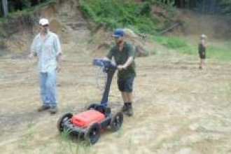 Two people using a ground penetrating radar machine