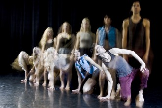 5 BFA senior dancers in a line crouching and standing