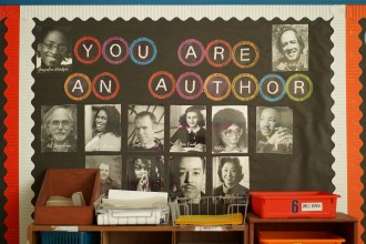 "A wall decoration featuring photos of several authors reads ""you are an author."""