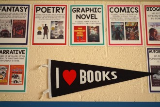 "A pennant reading ""I heart books"" hangs on the wall of Hampton's classroom."