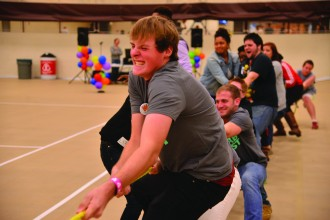 A group of students plays tug of war.