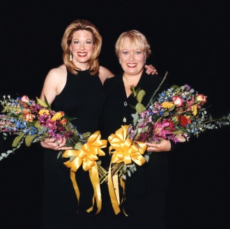 Mazzie and Barbara Marineau pose with flowers.
