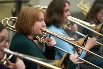 Alayna O'Connell plays trombone.