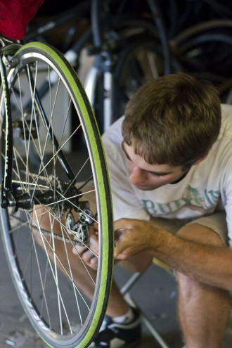 Steve Makuch adjusts a derailleur at open shop night