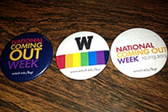 Photo of buttons depicting National Coming Out Day.