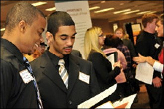 Photo of students at a career fair.