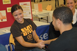 Photo of a student receiving a hand massage.
