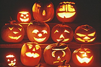 Photo of several jack-o-lanterns sitting on staircase.