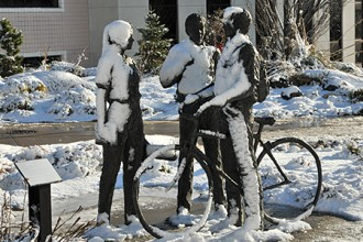 Photo of snow-covered sculpture.