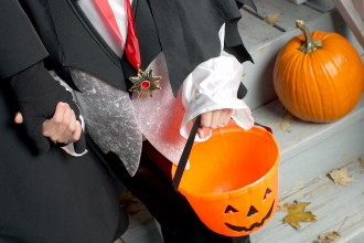Photo of young child trick-or-treating.