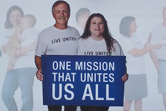Photo of United Way billboard featuring Wayne Fuqua and Jessica Parker.