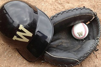 Photo of WMU batting helmet, baseball and glove.