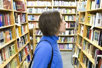 Photo of student in bookstore.