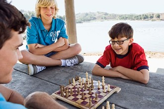 Photo of young boys playing chess.