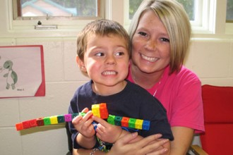 Photo of teacher and student at Children's Place.