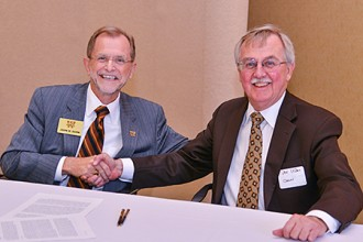Photo of WMU's John M. Dunn and Cooley's Don LeDuc.