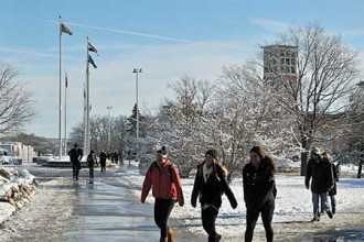 Photo of Campus Flagpoles in winter.