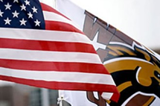 Photo of American flag with WMU flag behind it.