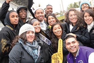 Photo of WMU Homecoming King with students.
