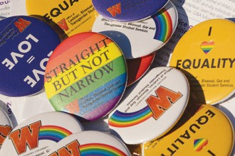 Photo of buttons in support of gay rights.