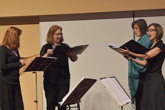 Photo of women singing at the medieval conference.