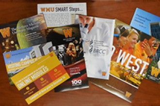 Photo of University brochures and other printed materials.
