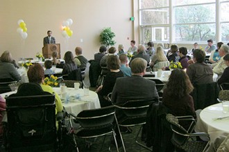 Photo of service-learning campus and community breakfast.