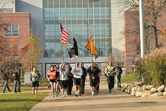 Photo of runners in Veterans 5K race.