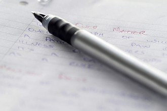 Photo of a pen on paper.