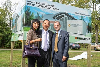 Photo of the Zhangs and President Dunn at the center's groundbreaking.