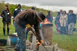 Photo of a blacksmithing demonstration.