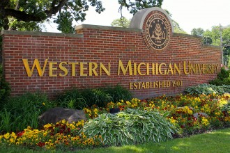 Photo of a WMU sign in summer.