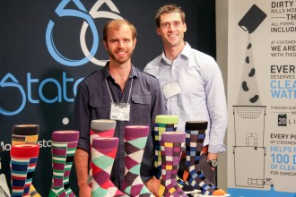 Photo of the founders of BoldSocks with their product.