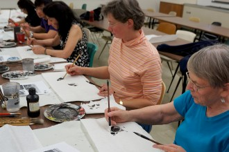 Photo of students painting in a Confucius Institute class.