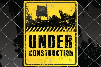 Photo of a fence and construction sign.