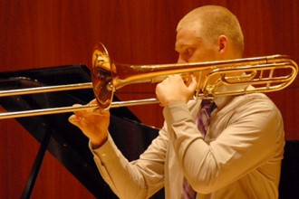 Photo of Nick Dewyer playing the trombone.