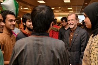 Photo of students talking with Dr. Dunn at the 2013 International Festival.