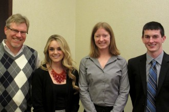 Photo of scholarship winners with their major program director.