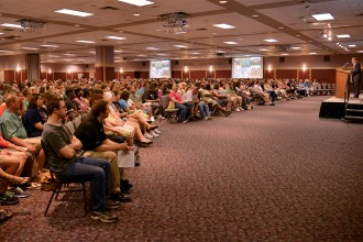 Photo of President Dunn speaking at New Student Orientation.