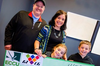 Photo of Rosie Hall and family holding first-place competition prize.