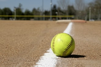 Photo of a softball on the infield.