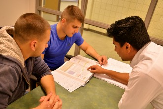 Photo of students gathering to study.