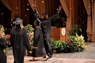Photo of a WMU graduate during commencement.
