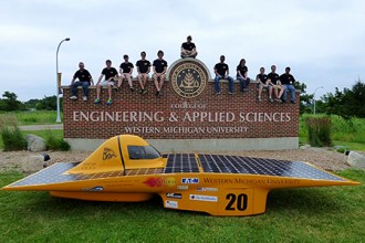 Photo of members of the Sunseeker solar car team.
